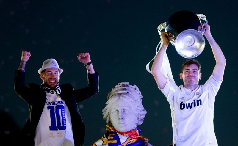 Casillas and Sergio Ramos lifting the Champions League trophy in the Cibeles, Madrid