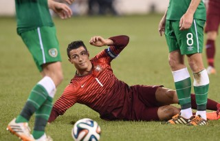Cristiano Ronaldo laying down on the ground injured, in Portugal vs Ireland in 2014