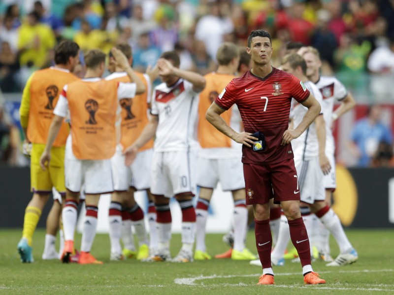 Cristiano Ronaldo lonely moment with Germany celebrating just behind him, at the World Cup 2014