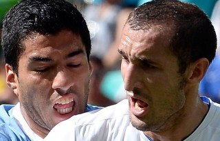 Luis Suarez preparing to bite Chiellini, in the FIFA World Cup 2014