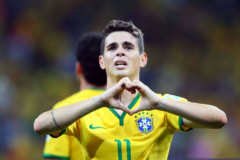 Óscar in Brazil's goal celebration, making a heart gesture with his hands, in World Cup 2014