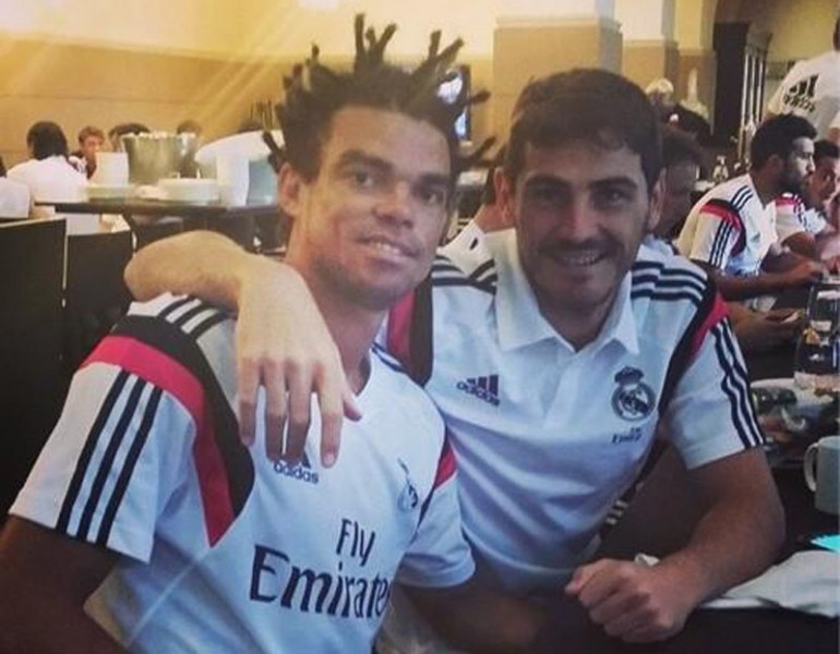 Casillas laughing of Pepe's new look and haircut style in 2014