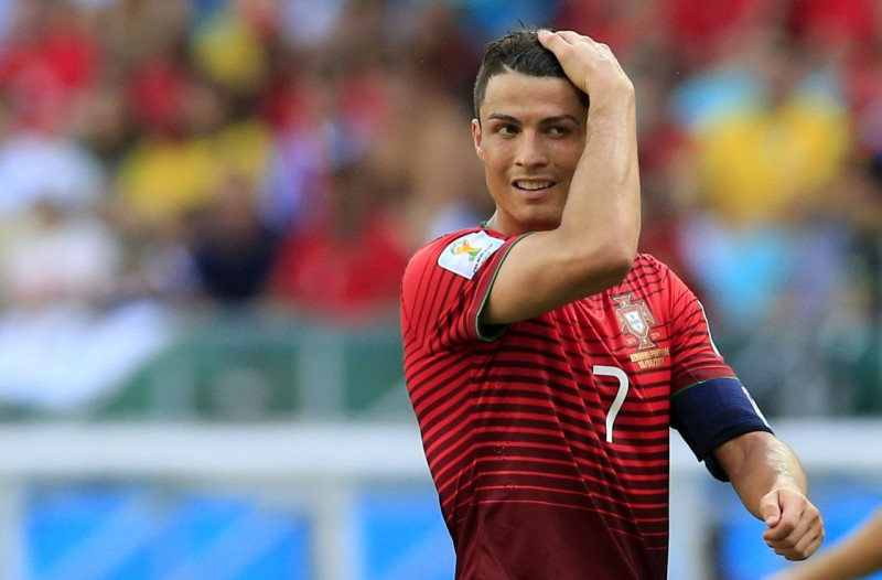 Cristiano Ronaldo combing his hair during the 2014 FIFA World Cup