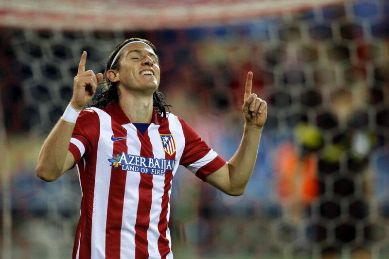 Filipe Luis celebrating goal by pointing his fingers to the sky