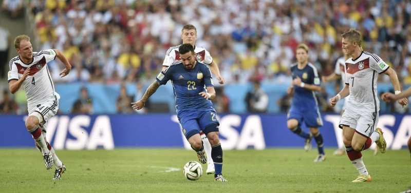Lavezzi running away from Germany defenders in the FIFA World Cup final of 2014