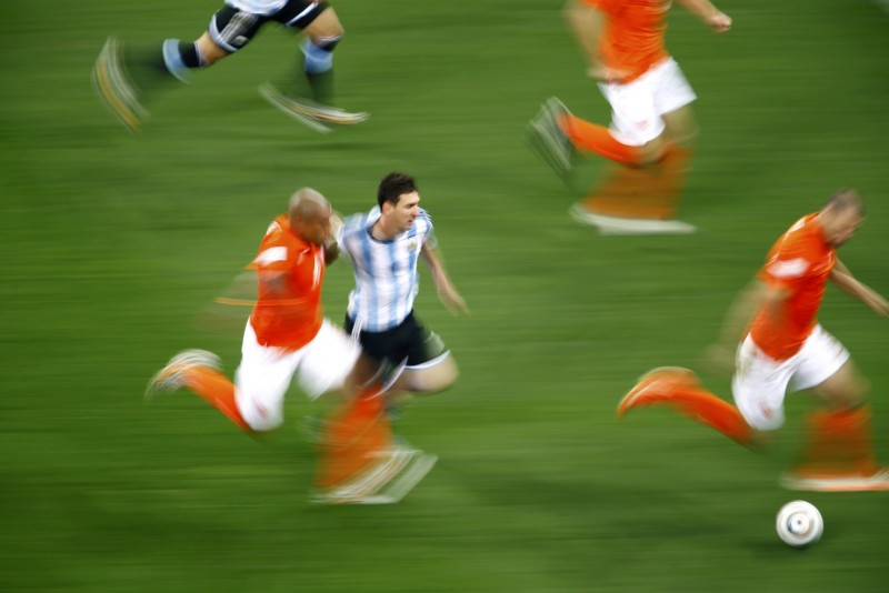 Lionel Messi racing past De Jong, in Argentina vs Netherlands, at the 2014 FIFA World Cup