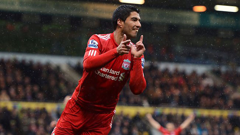 Luis Suarez showing his teeth after scoring for Liverpool