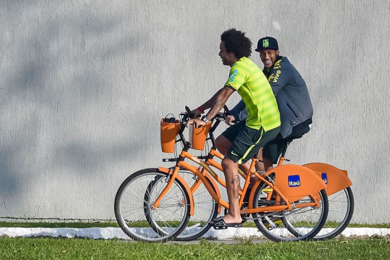 Marcelo and Neymar riding a bicycle