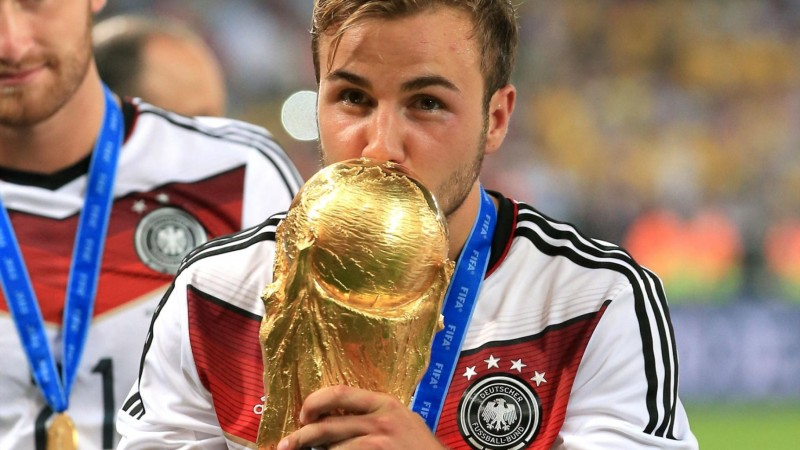 Mario Goetze kissing the FIFA World Cup trophy