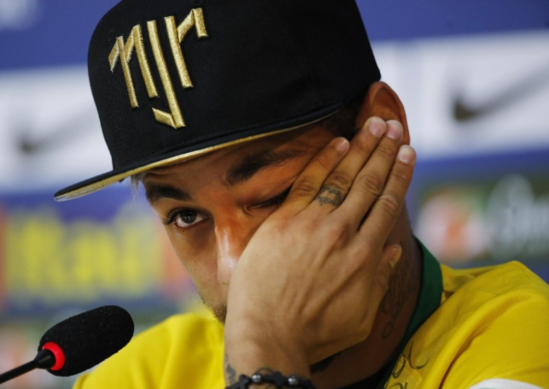 Neymar wiping the tears of his face after crying
