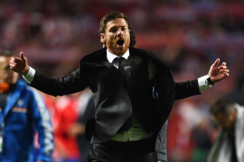 Xabi Alonso suited up, celebrating Real Madrid goal in the Champions League final