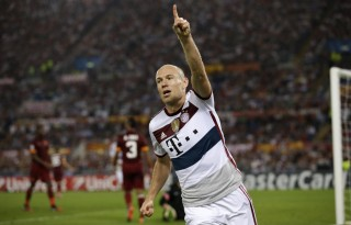 Arjen Robben celebrating Bayern Munich goal in a white shirt