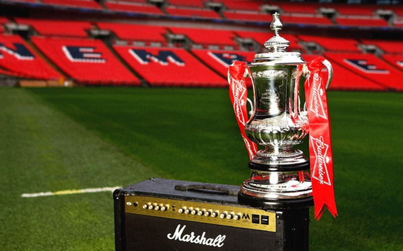 The FA Cup trophy being shown at Wembley