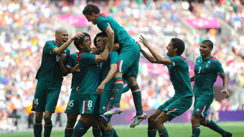 Mexico players after scoring a goal