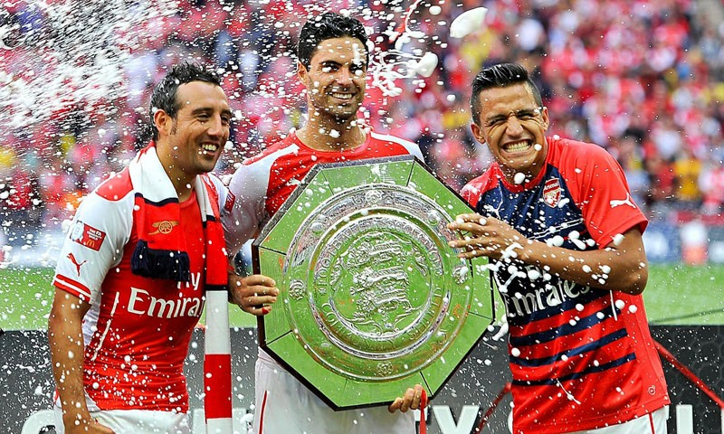 Cazorla and Alexis Sánchez winning silverware for Arsenal