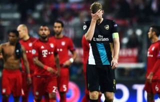 Mertesacker covers his face in shame, after Arsenal got humiliated against Bayern Munich