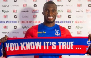 Crystal Palace's Benteke holding a you know it's true scarf
