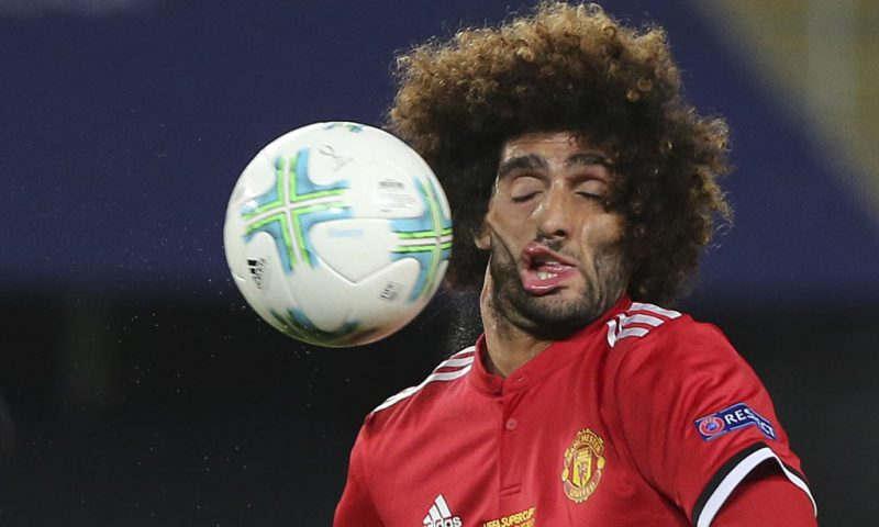 Fellaini ugly face after being hit by a ball