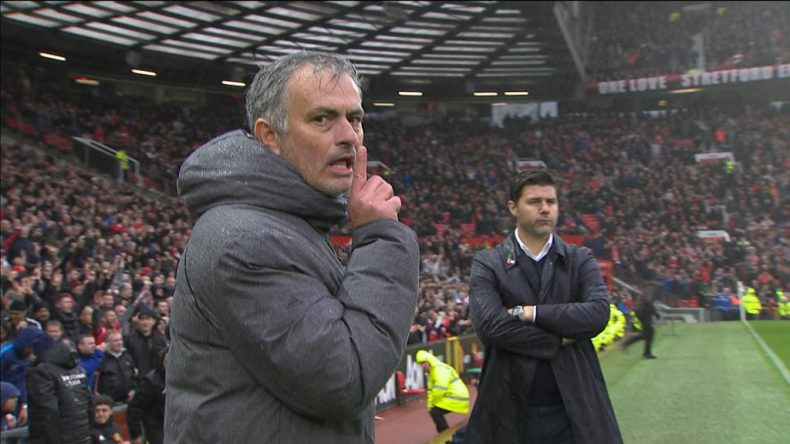 José Mourinho reacts to the cameras in front of Pochettino after Manchester United beats Tottenham in 2017