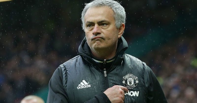José Mourinho points to Manchester United badge