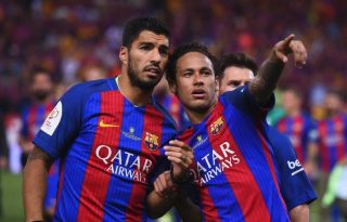Neymar next to Luis Suarez