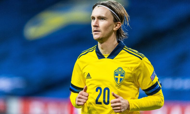 Kristoffer Olsson playing for the Swedish National Team